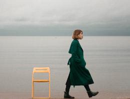 woman walks alone on beach