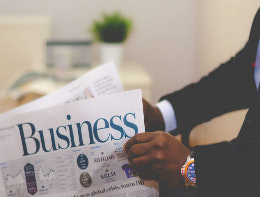reading business newspaper