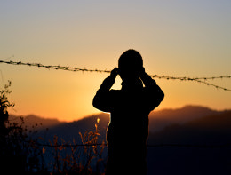refugee child barbed wire